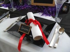 Cute idea for the table setting.  Roll napkin up and make it look like a diploma. Also write guest name in chalk