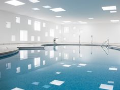 Pool & Spa at Hotel Castell dels Hams ::  A2arquitectos.  Designers Take Plunge with Geometric Design  Linear cubic windows contrast the fluidity of flowing water at a new swimming pool and spa in Majorca, Spain.