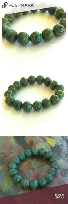 Ceramic beaded bracelet BNWoT Greenish blue glaze swirls encapsulate these lovely ceramic beads. 16 beads on the bracelet which is on elastic so it will fit any wrist. Brand new without tags. This will go with everything. From India. Bundle for an additional 10% savings. Please Jewelry Bracelets