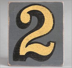 Hand-painted grey wooden number sign: '2'