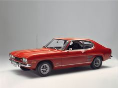 Ford Capri Mk1 my dads was a 1300 gtxlr. It had a black bonnet and an H reg. nice car. Black leather seats. Very very slow though.