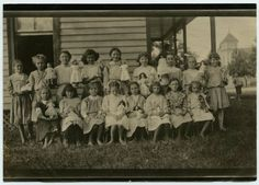 In honor of the first day back to school for a lot of our public schools, here's a photograph of a group of school girls holding dolls. I like to this is was show and tell doll edition.  A group of school girls pose outside, each girls holding a doll, circa 1900.