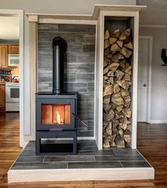 This is probably my favorite house project to date. Dave and I bought ourselves a wood stove for Christmas. It took me 3 weekends to build… Wood Stove Surround, Wood Stove Hearth, Stove Fireplace, Wood Stove Wall, Corner Wood Stove, Home Projects, Garden Projects, My Dream Home, Future House