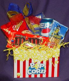 Basket Bunch gift basket with popcorn, cookies, candy, and soda