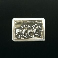 Sterling Krementz Kentucky Derby Horse Racing Pin 2 jockeys racing their horses are depicted in this beautifully detailed pin. Made of sterling silver by Krementz, it is stamped patent pending Sterling and Krementz. The sterling stamp places it pre 1964, while the practice of using pay pending stamps died out in the 1950s and was at its heyday in the 1920s-1940s. I'm excellent condition for its age. A few surface scratches on the back and a replacement pin back are the only flaws. Vintage…