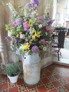 Milk churn arrangement - flowers provided by Honey Pot Flowers and arranged by friends of the bride.