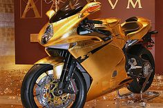 .if by any chance the mv agusta is to simple for ya, here's the golden mod - fully covered with 24carat gold. For mere 120k$ =p