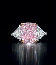 A rare 10.07 carats Type IIa cushion modified brilliant-cut fancy intense purple-pink diamond and diamond ring