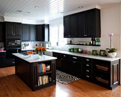 dark with white accents... don't like the wood floor paired with it, would need another color or tile. hmm