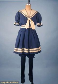 """LADIES BATHING COSTUME, SHOES & FLOATS, c. 1900  Marine blue lightweight wool, white sailor collar & trim, button-on skirt, labeled """"Arnold Constable & Co. New York"""", B 34"""", W 25"""", L 40""""; 1 pair black cotton knit thigh-high canvas sole bathing shoes & set of """"Aybad's Water Wings Patented May 7, 1901""""."""