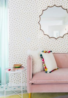 pink velvet sofa + polka dot wallpaper