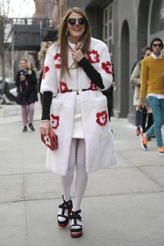 This coat looks really warm!  flarefashion:    New York Fashion Week- Street Style / Photographer: Anthea Simms  Let these street style darlings inspire your next outfit. Over 120 snaps inside!