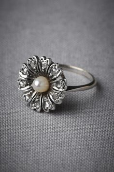 """Hailing from England in the 1930s, a pearl-centered flower with petals of rose cut diamonds ensures your """"something old"""" is covered. 14K white gold, rose cut diamonds, pearl. Handmade."""