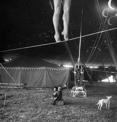 """From the April 4, 1949 feature story—CIRCUS GETS READY: The Big show's girl learn arcrobatics from the ground up for grand tour. This image ran with the following caption: """"Nothing but circus all day every day is the happy fate of these two..."""