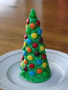 sugar cones (ice cream cone), frosting, green food coloring, m&m;'s.  Paint the frosting (painted green) onto the cone, add m and m's to it. - For an afternoon project with the boys in December