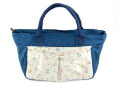 Water resistance everyday handbag with personalised zip tap