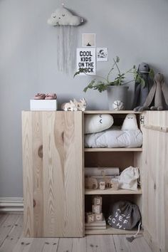 A sweet and simple kids room in grey, wood and hints of white - beautiful!