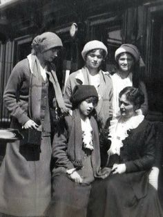 OTMA & their mother Alexandra, 1913 < Anastasia looks like she's telling her mother something bad that she's done because Tatiana made her tell her (with her hand on her just in case she runs) while Maria spots the camera and Olga's trying to concentrate on her sister.