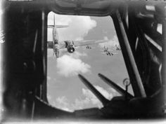 A formation of Martin Baltimores of No. 232 Wing RAF flying to attack enemy positions during the Battle of El Alamein, seen through the lower gun hatch of another aircraft.