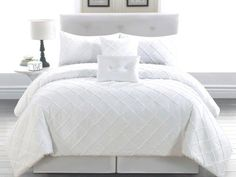 white bedding sets, wonderful for designing a truly unique bedroom. throw a splash of color here and there and make it your own.
