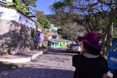 Burgundy hat and traveling through the streets of Santa Lucia,Honduras
