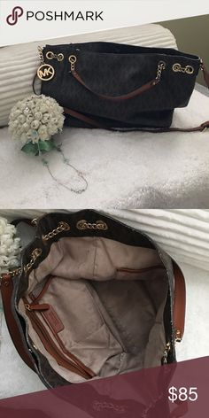 Purse A really nice shoulder bag with long strap. Good condition. Well taken cared. Loved this bag! MICHAEL Michael Kors Bags Shoulder Bags
