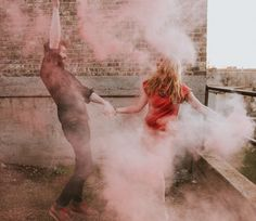 20 - Couple Holding Hands In Pink Colored Smoke Bomb