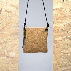 Ingenuity at its finest! This cross-body bag takes inspiration from Gaia, the gold-plated zipped closure allows secure storage of personal possessions. Crafted from corkwood, Jeannette Jovel is water resistant and perfect for summer! We suggest adding this to your wardrobe without delay. Available in tan and black.