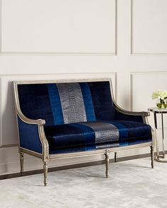 """MassoudLilah Navy Colorblock Settee Price:  $2,899.00 Shipping:  $250.00      Handcrafted settee.     Hardwood frame.     Cotton/rayon and leather upholstery.     56""""W x 31""""D x 39""""T. Seat, 48""""W x 21""""D x 19""""T; arms, 25""""T.     Nailhead trim.     Made in the USA.     Boxed weight, approximately 100 lbs."""