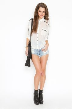 cute white blouse with black accents that would look awesome with black pleather pants, and a black boat-hat