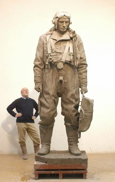Philip Jackson stands with his Wireless Operator that can be seen in Green Park, London.