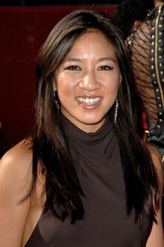 Michelle Kwan  (born July 7, 1980)  most decorated female American figure skater.   She is a two-time Olympic medalist (1998 Silver at Nagano, 2002 Bronze Salt Lake City), a five-time (1996, 1998, 2000, 2001 and 2003) World champion and a nine-time (1996, 1998–2005) U.S. Champion  Currently serves as a U.S. State Dept. staffer - United States public diplomacy ambassador.  She is a writer and philanthropist.  Chosen for her grace, innovation, determination and service to her country.