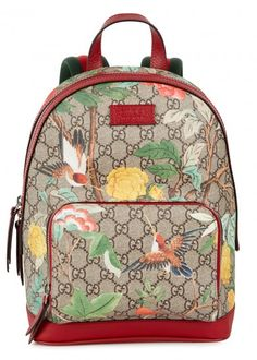 Gucci taupe coated canvas backpack with red leather top handle, signature striped canvas shoulder straps, monogrammed, printed and red leather trims.