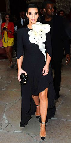 KIM KARDASHIAN - in a dramatic black dress with a high-low hemline and sculptural white embellishment