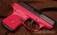 Rugar LCP 380 in Rasberry.... it's pretty.  not only did i shoot your ass with a gun, but i did it with a pink gun, dirtbag.  lol  ok, i hoping to NEVER have to use it! When i get my conceal and carry this is what i want!!!!