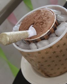 keep ice cream cold-but surround in a purple and blue snowflake icecubes-and a metal bucket:)