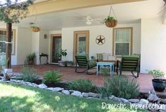 Spacious front porch made for entertaining...lots of budget friendly projects and ideas!