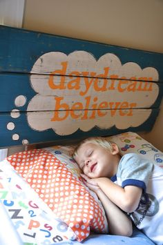 Such a cute custom headboard!  OR could be a sign hanging in the room.