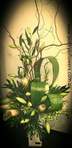 Corporate Flowers - tall vase arrangement of oriental lillies, protea, green singapore orchids & anthurium