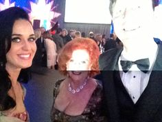 Grant Snyder with Katy Perry at auction