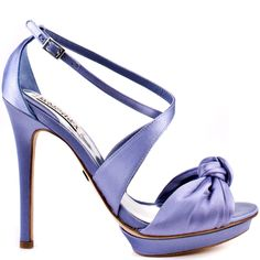 This fancy sandal will make them green with envy.  Badgley Mischka beautiful Wallis II style features a periwinkle satin upper and cute knot detail at the vamp.  Two strap overlap each other to create and adjustable ankle strap.  Perfecting this breathtaking pump is a 1 inch platform and 4 1/2 inch heel height.