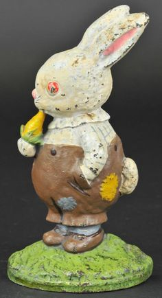 PETER RABBIT WITH CARROT DOORSTOP Hubley, Grace Drayton design, cast iron, depicts whimsical chubby white rabbit in brown patched pants, nibbling carrot on green base.