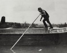 """Caption: """"Boatman poling a boat on the Regent's Canal"""" BW192-3-2-2-28-89"""