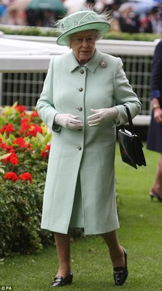 Bets are off! The Queen's hat choice today was a mint green creation by Rachel Trevor Morgan. The monarch, who wore a pale mint coat by one of her favourite couturiers, Stewart Parvin, carried one of her favourite Launer handbags, wore Genevieve Lawson gloves and a pearl brooch on her lapel