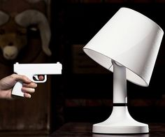 Control the lighting in your home with the pull of the trigger with these remote controlled gun lamps. With a range of nearly fifty feet, the lamp shade will tilt its angle when you shoot it to turn the light off. It's a great way to brighten up an otherwise peaceful home.