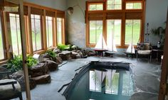 """slate-surrounded """"endless pool"""" where you can swim laps against a current without ever moving. The home was originally a 1907 New England church that was blended in 2004 with an architect- designed"""