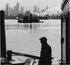 """mpdrolet: """"Deck hand, New York Central Railroad, with New York Central N. 24 in background, in Hudson River, Weehawken, NJ, 1963 David Plowden """""""