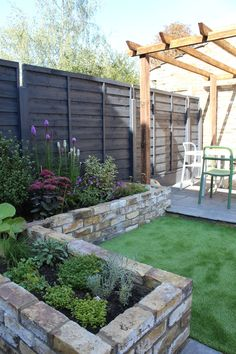 Raised beds and pergola in small London Garden
