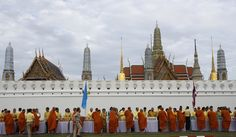 Buddhist monks line up receive offerings from devotees outside Grand Palace during the 70th anniversary celebrations of Thai King Bhumibol Adulyadej's accession to the throne in Bangkok, Thailand, Thursday, June 9, 2016. (Sakchai Lalit / The Associated Press)