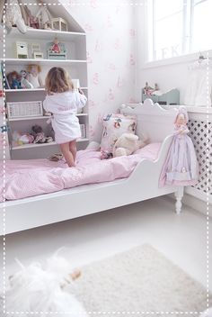 Love this little girls bedroom - the white with hints of pink & Beatrix Potter theme. Also the shelves and the miniature furniture etc!